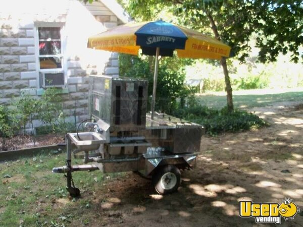 Stainless steel hot dog cart with traditional blue and yellow Sabrett's umbrella; cart passed Hartford County, MD's very strict health dept. inspection. See details for features.