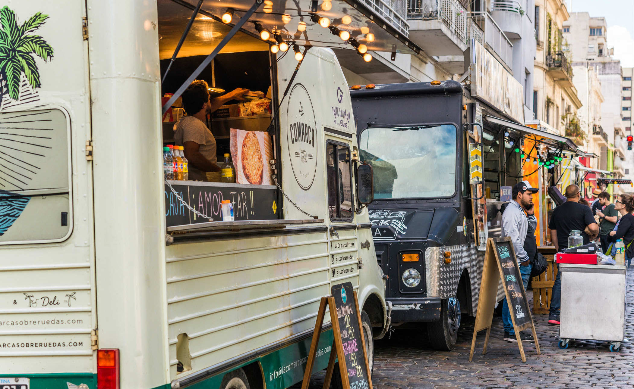 food trucks parked next to each other on a street