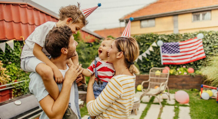 family of four celebrating fourth of july in a backyard