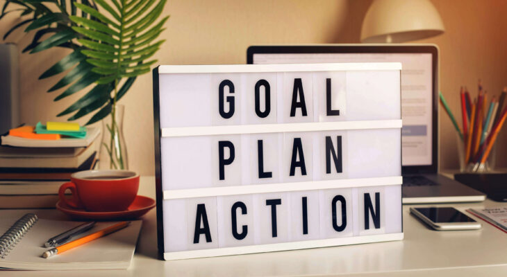words on a desk saying goal, plan, action