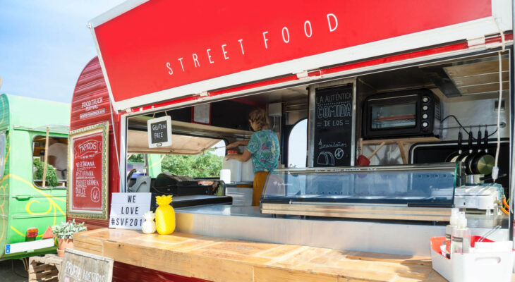 "red food truck labelled ""street food"""