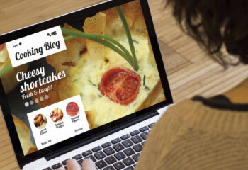 woman using laptop to browse a cooking website