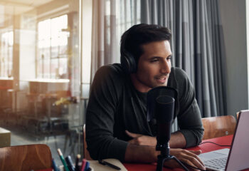 man doing podcast in a bright room