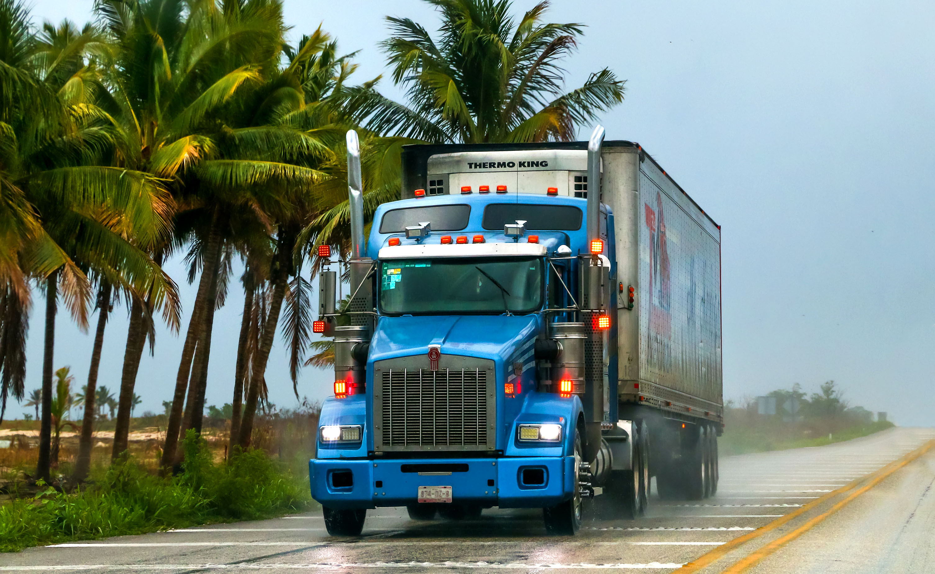 Blue semi-truck on a highway