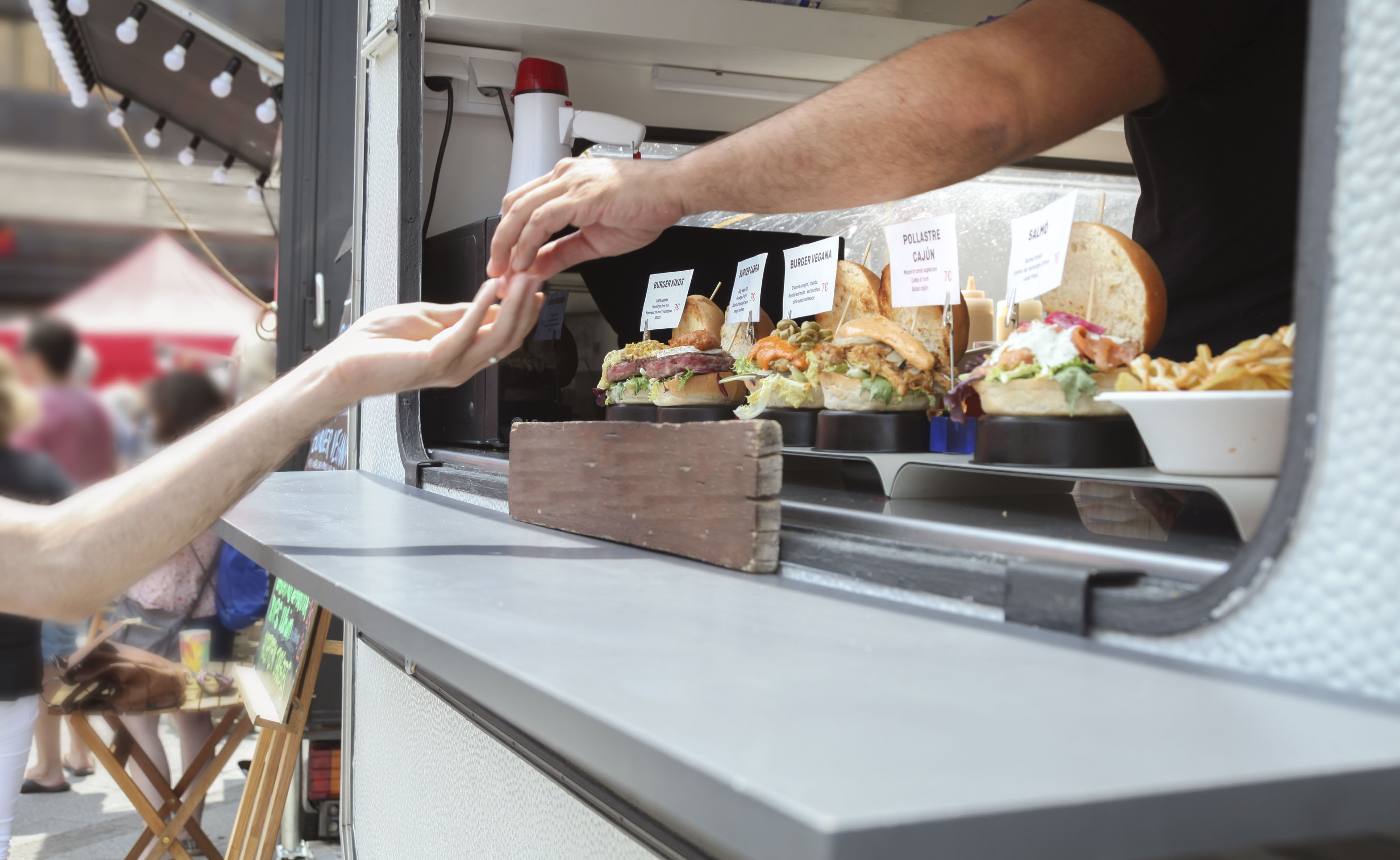 food truck owner handling change to customer