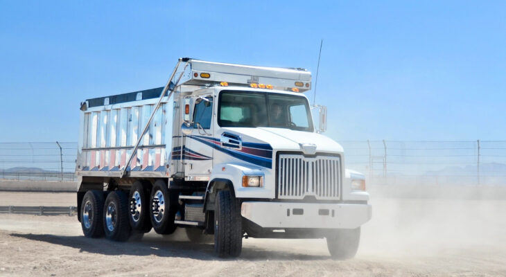 white dump truck on a dusty road