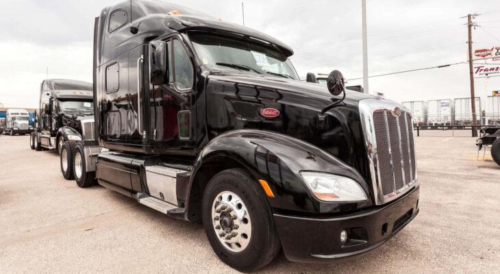 black Peterbilt 587 sleeper truck on a parking lot