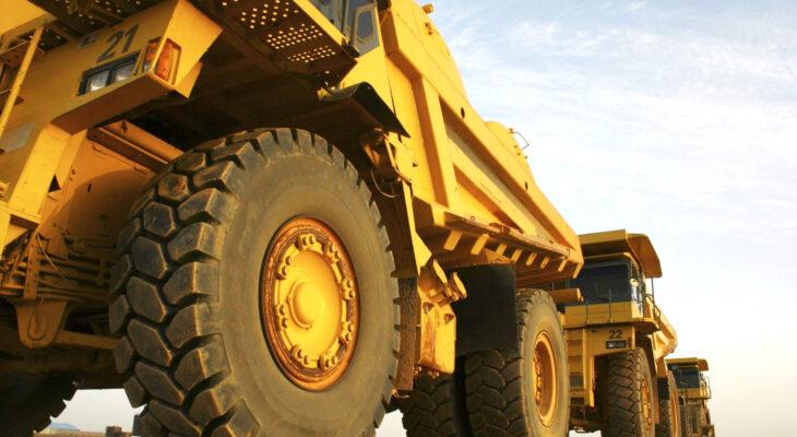 mining dump trucks on a construction site