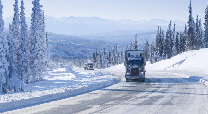 semi-truck driving on Dalton Highway in Alaska