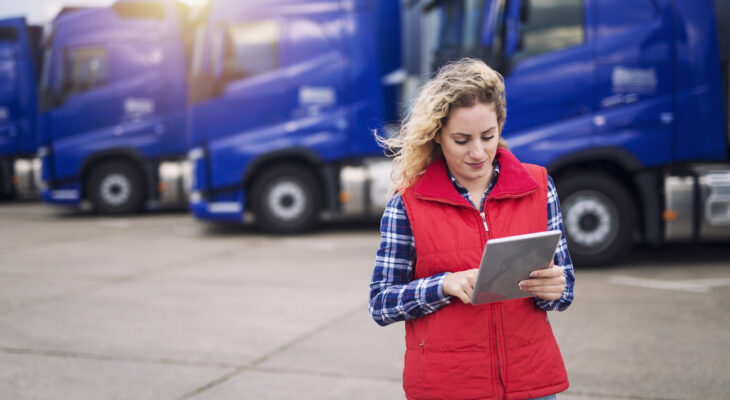 businesswoman looking at her trucking business' financial goals