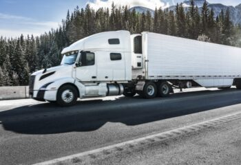white flatbed truck in a highway