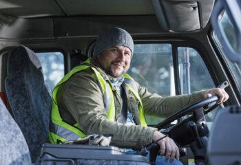 male truck driver sitting in his semi truck