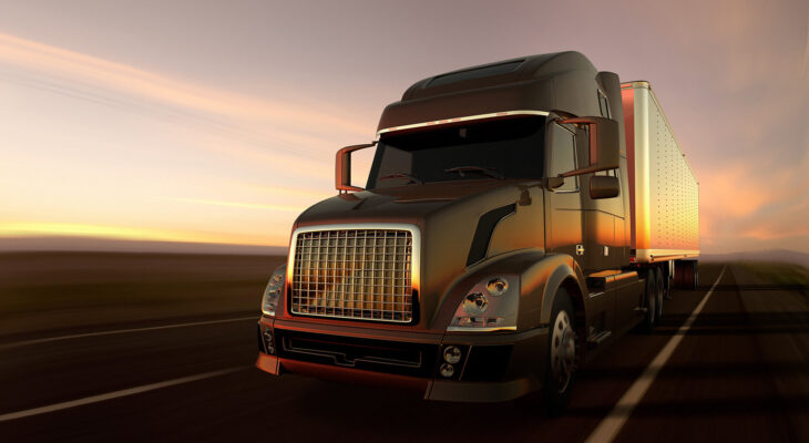 semi truck in a deserted road at dusk with visible truck lights