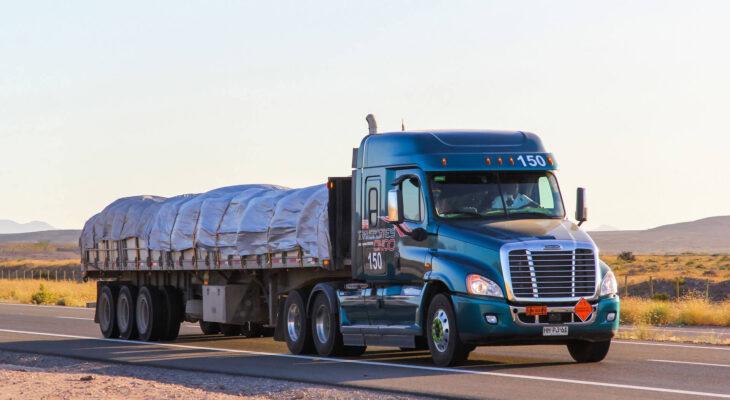 semi-trailer truck Freightliner Cascadia drives at the interurban freeway