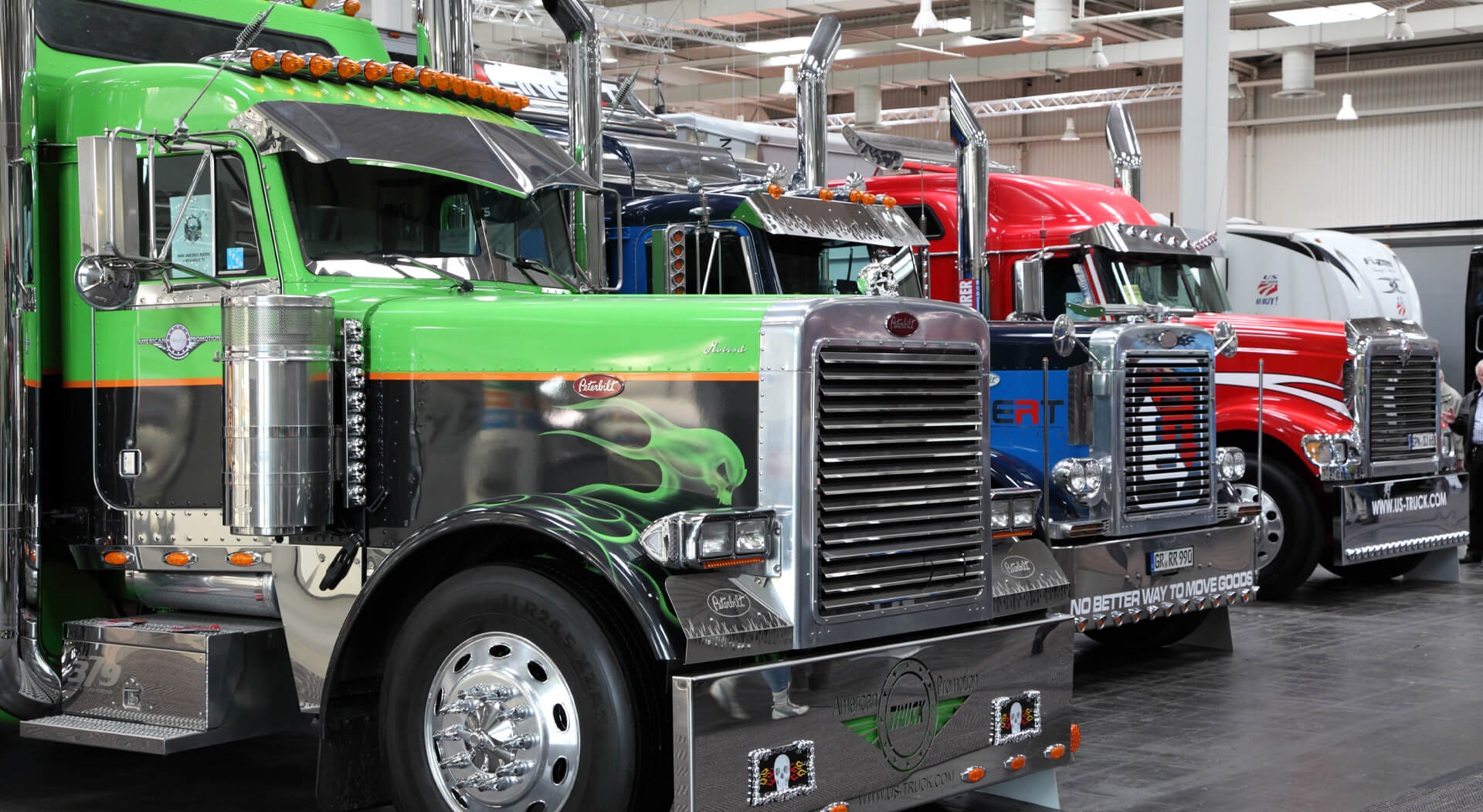peterbilt trucks displayed at an auto show