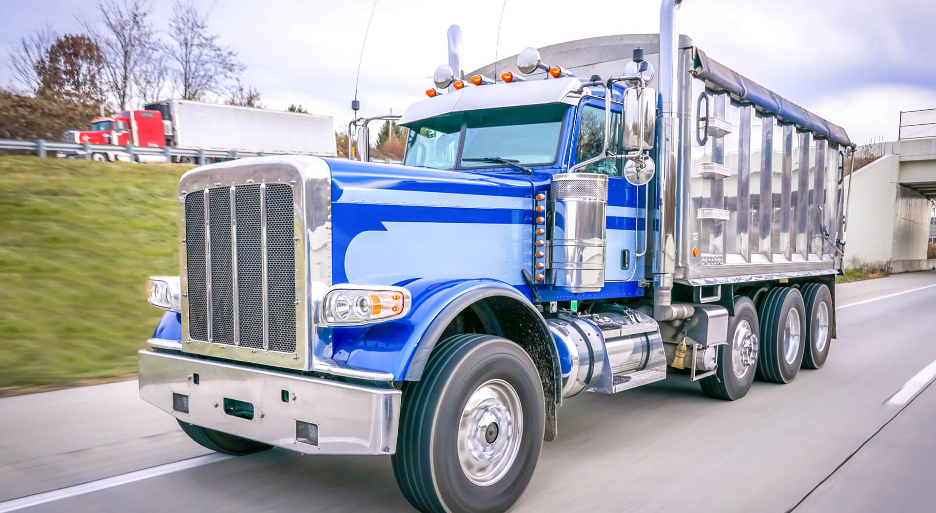 blue dump truck on a highway