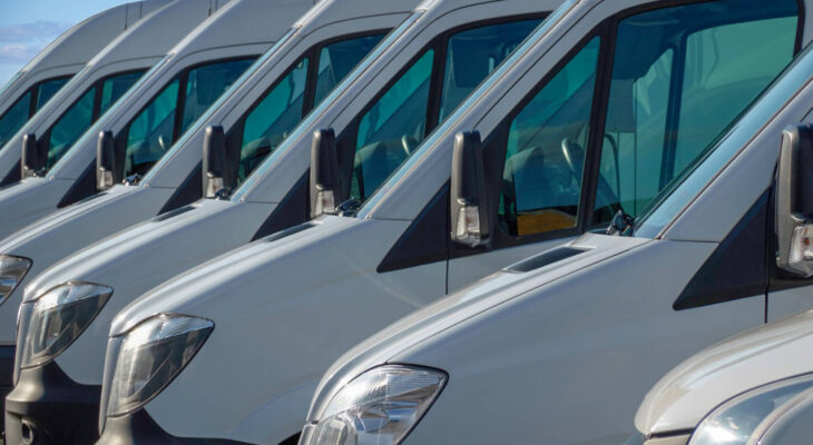 white transport vans are waiting for the next order