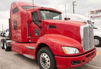 Kenworth T680 high-roof sleeper semi trailer truck at the dealership