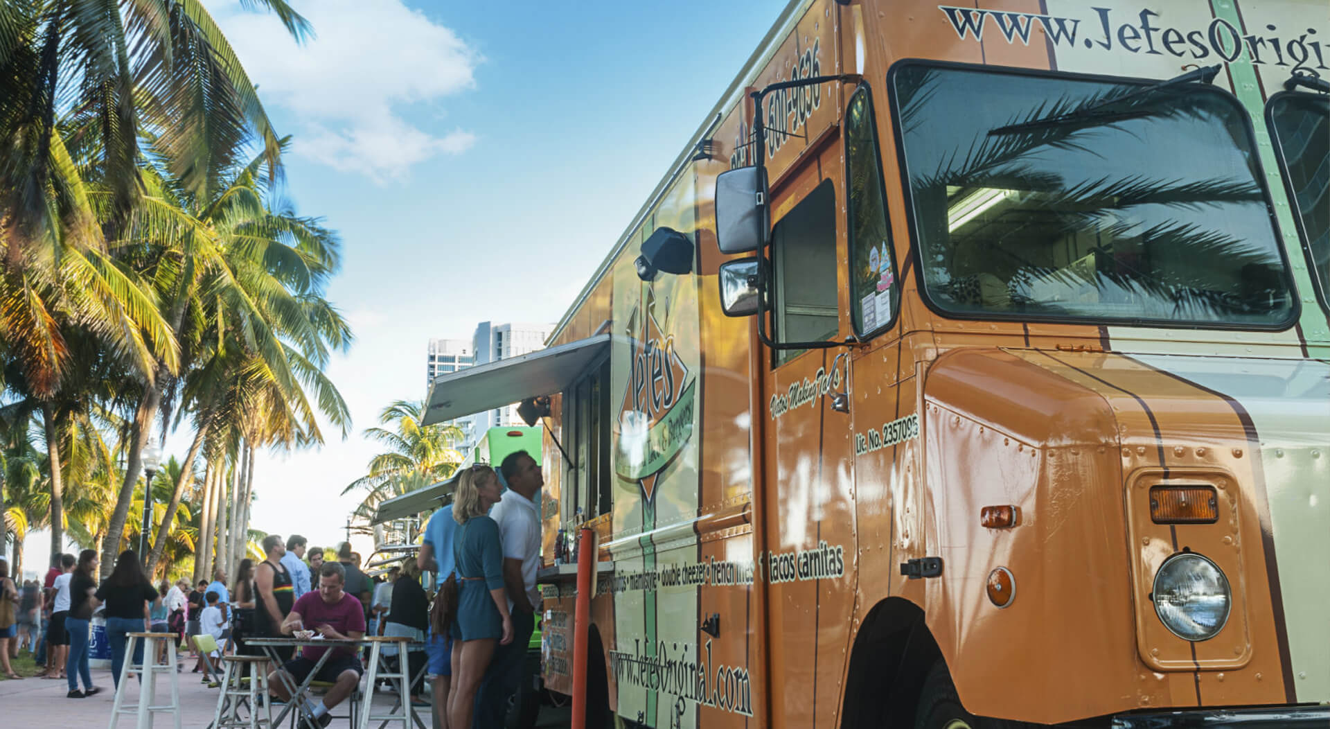 A food truck convoy serving a variety of delicious food making business at Miami Beach on a quiet Wednesday afternoon at a food truck fair