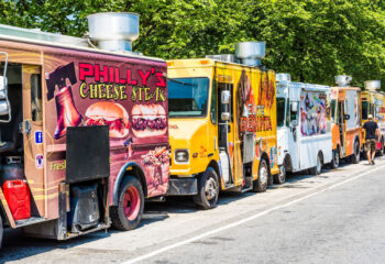 colorful food trucks lined up at a food festival