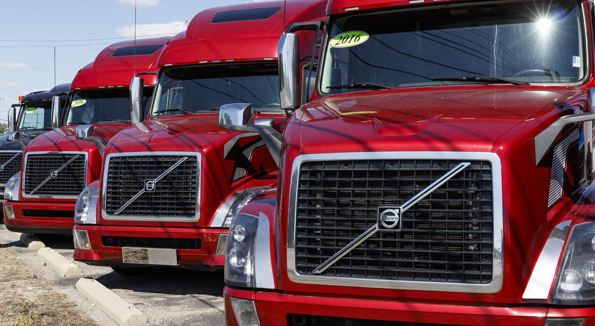 red Volvo trucks lined up for sale
