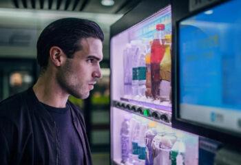 young guy using a vending machine