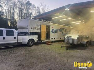Turnkey Business Wells Cargo BBQ Catering Concession Trailer w/ 2 Ford Trucks for Sale in Georgia!
