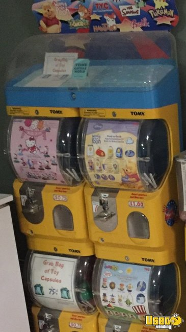 Tomy Candy / Capsule Rack Vending Machine Mississippi for Sale