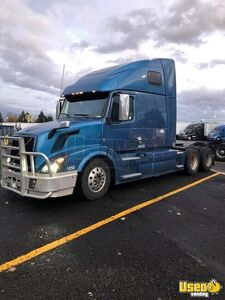 Solid 2015 Volvo VNL670 Hi-rise Sleeper Cab D13 Engine with I-Shift Transmission for Sale in Oregon!